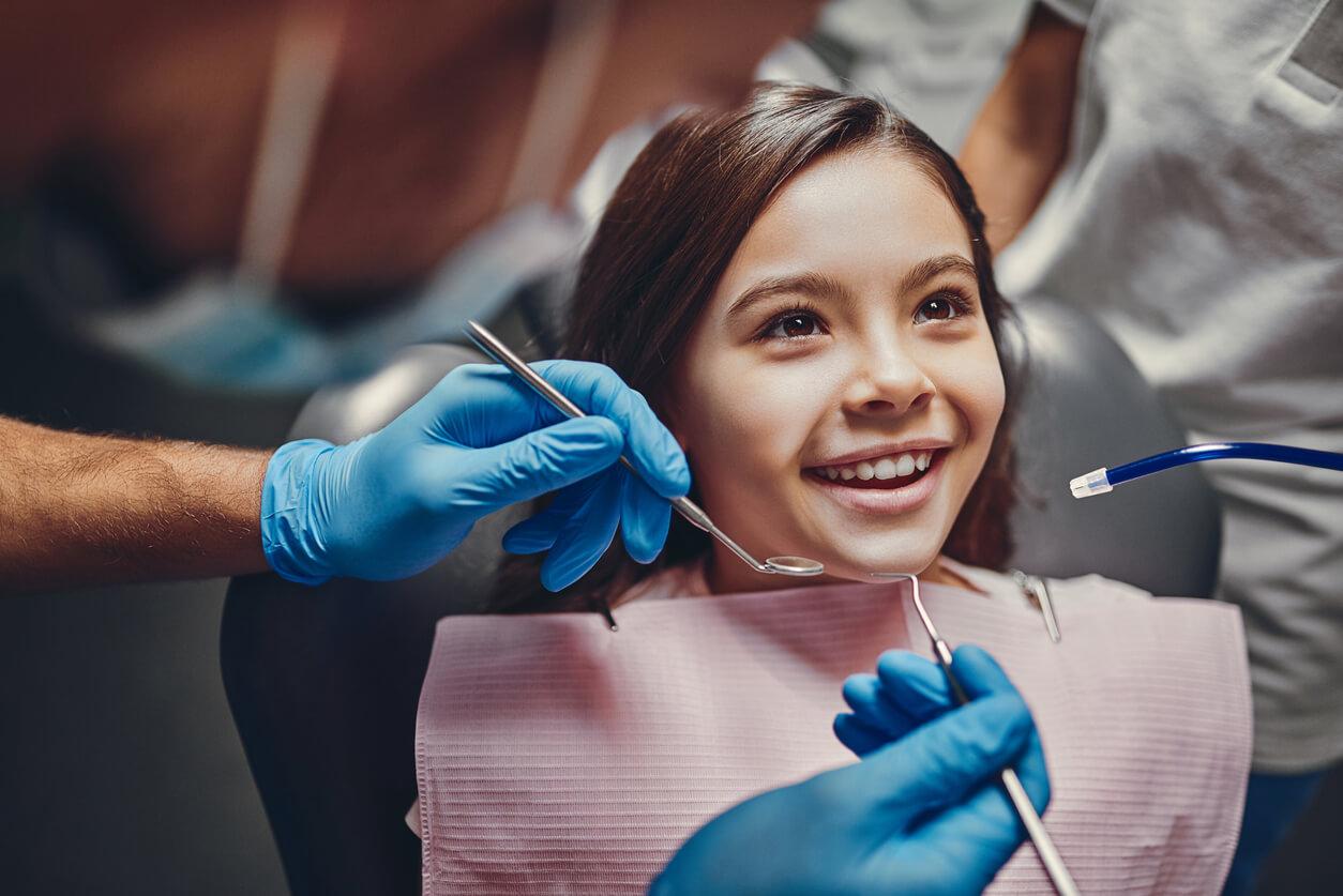 little girl in dental chair