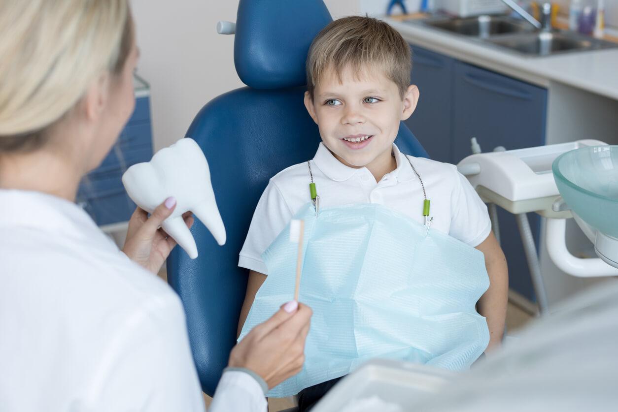 smiling boy in dental chair