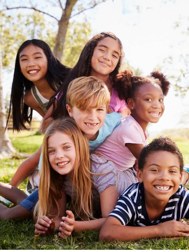 Smiling Children Outside Pediatric Dental Office