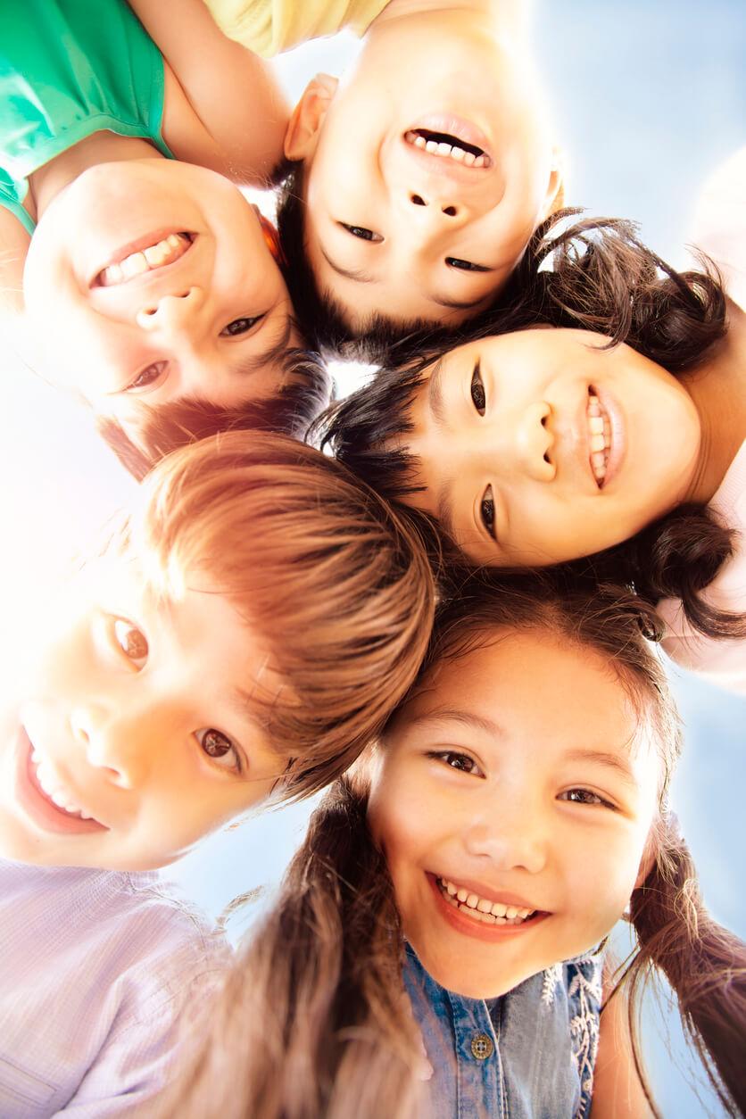 Smiling Kids Outside Pediatric Dentist Office